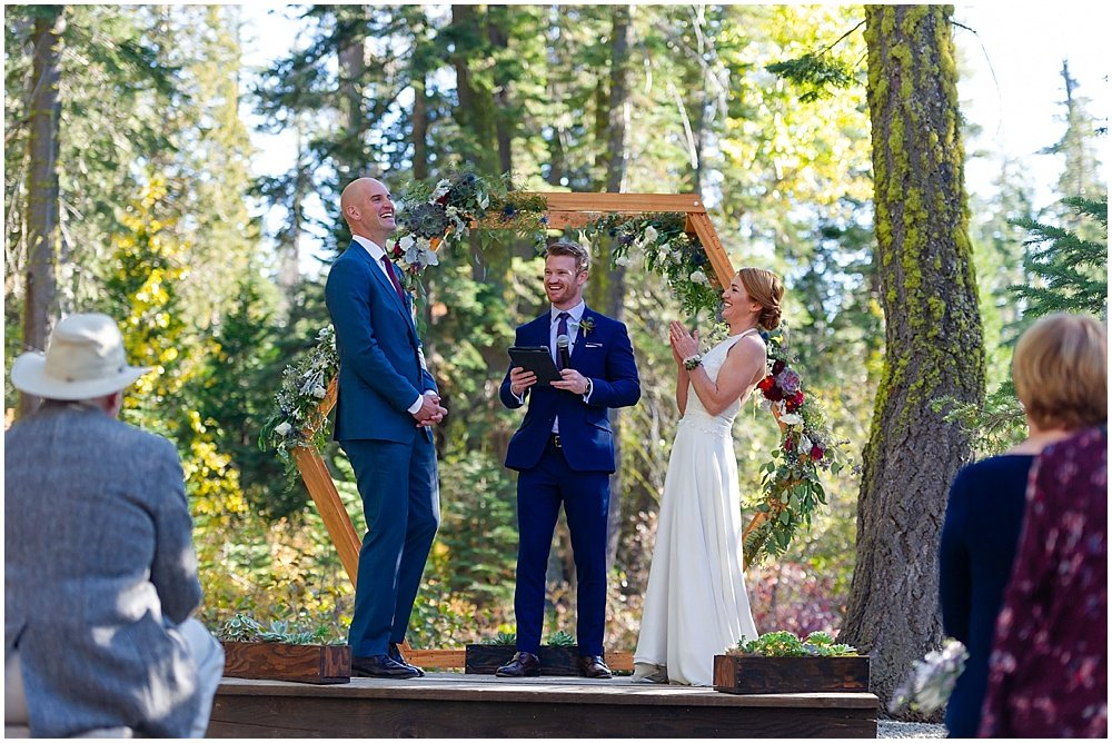 bride and groom laugh at gray eagle lodge wedding by chloe jackman photography