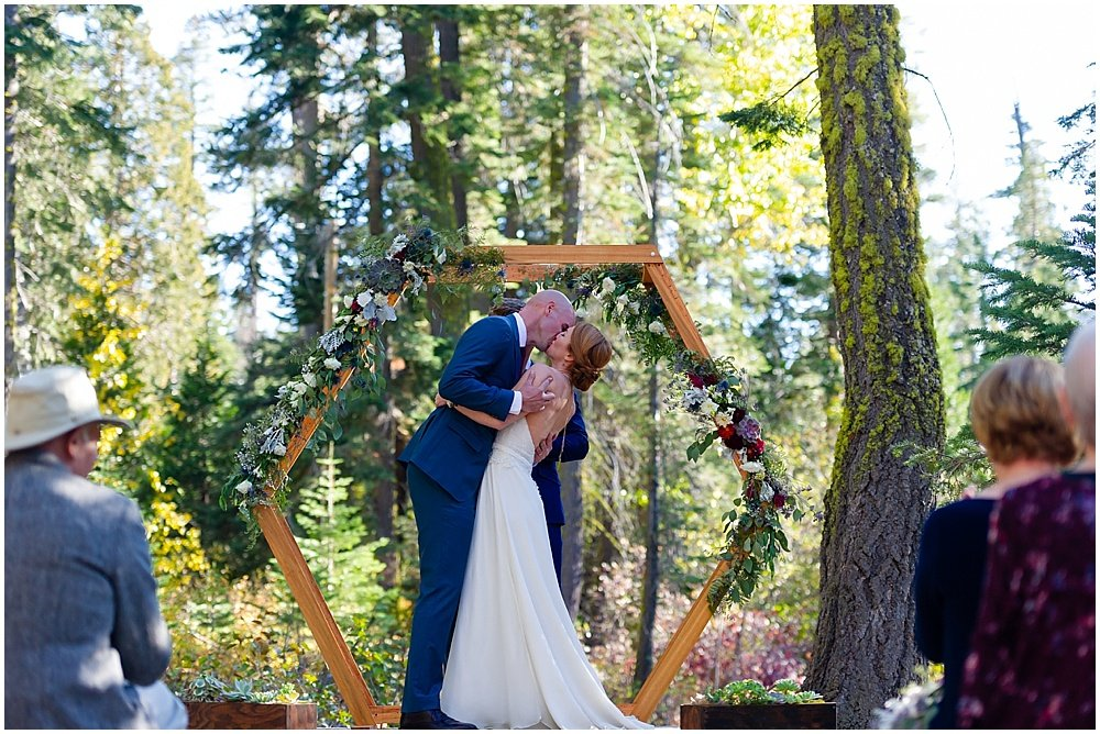 bride and groom kiss at gray eagle lodge wedding by chloe jackman photography