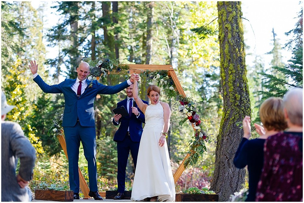 bride and groom cheer at gray eagle lodge wedding