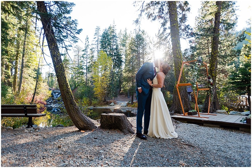 bride and groom kiss after gray eagle lodge wedding by chloe jackman photography