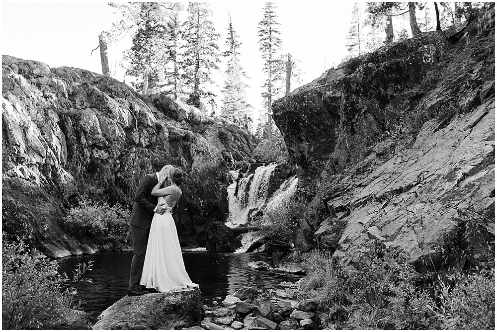 black and white of waterfall at gray eagle lodge wedding by chloe jackman photography