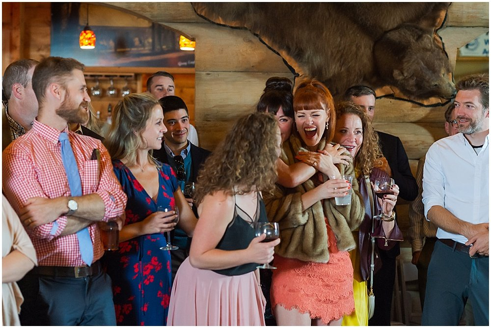 guests laugh during speech at gray eagle lodge wedding by chloe jackman photography