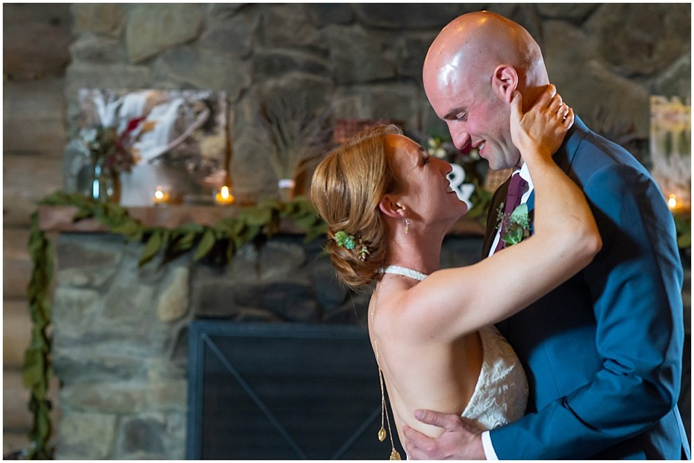 bride and groom look at each other lovingly at gray eagle lodge wedding by chloe jackman photography