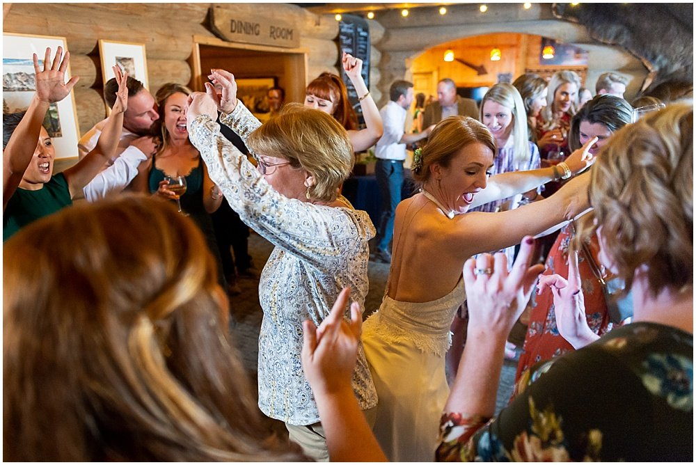 bride dances with mom as guests dance at gray eagle lodge wedding by chloe jackman photography