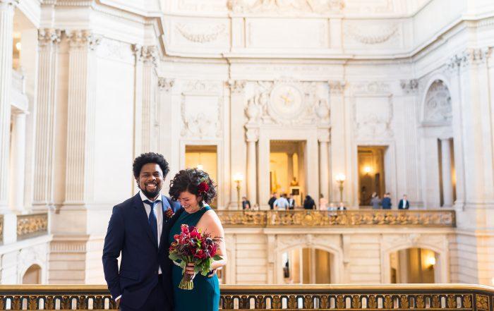 Couple pose at San Francisco City Hall wedding