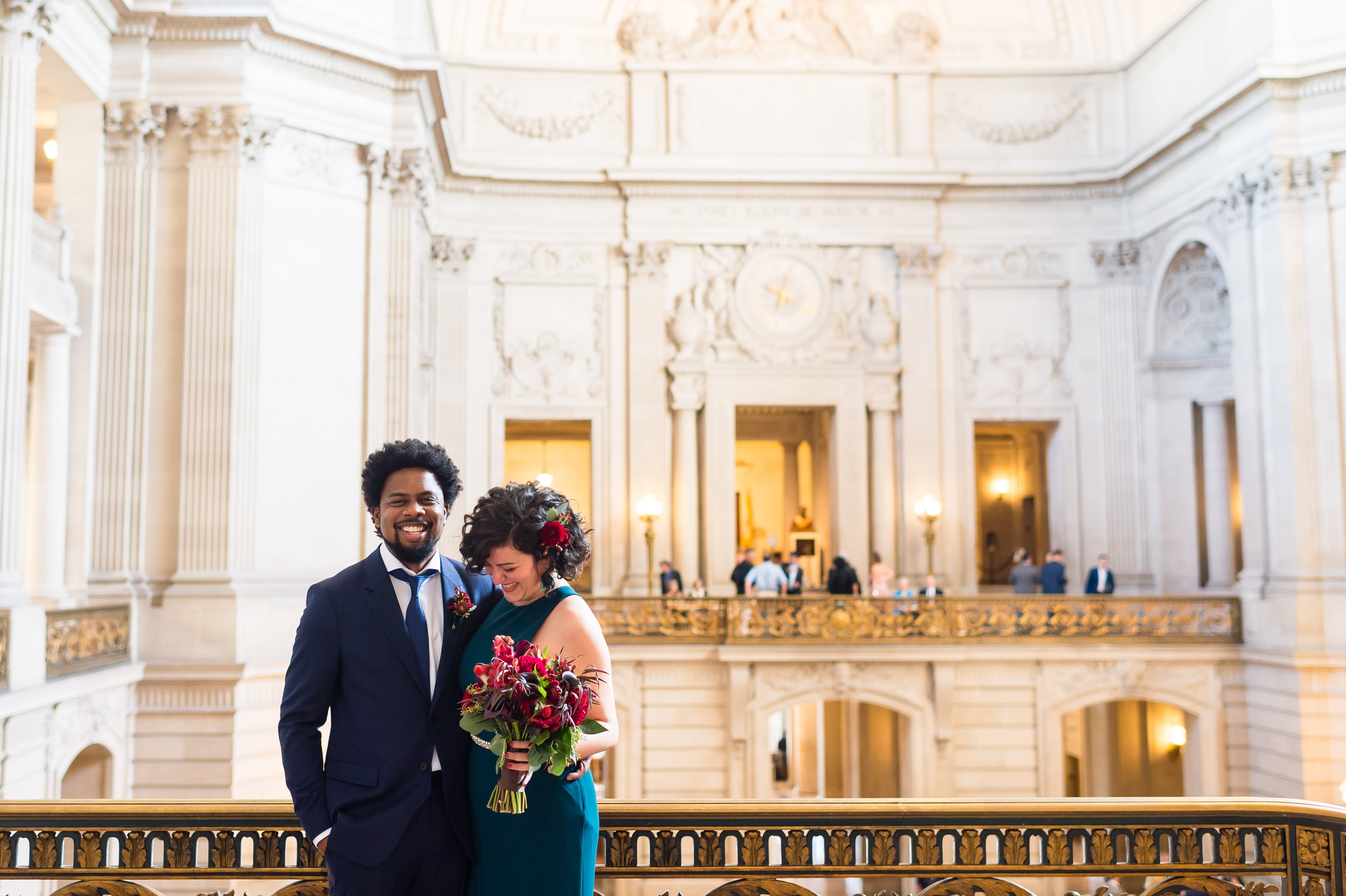 Couple pose at San Francisco City Hall wedding