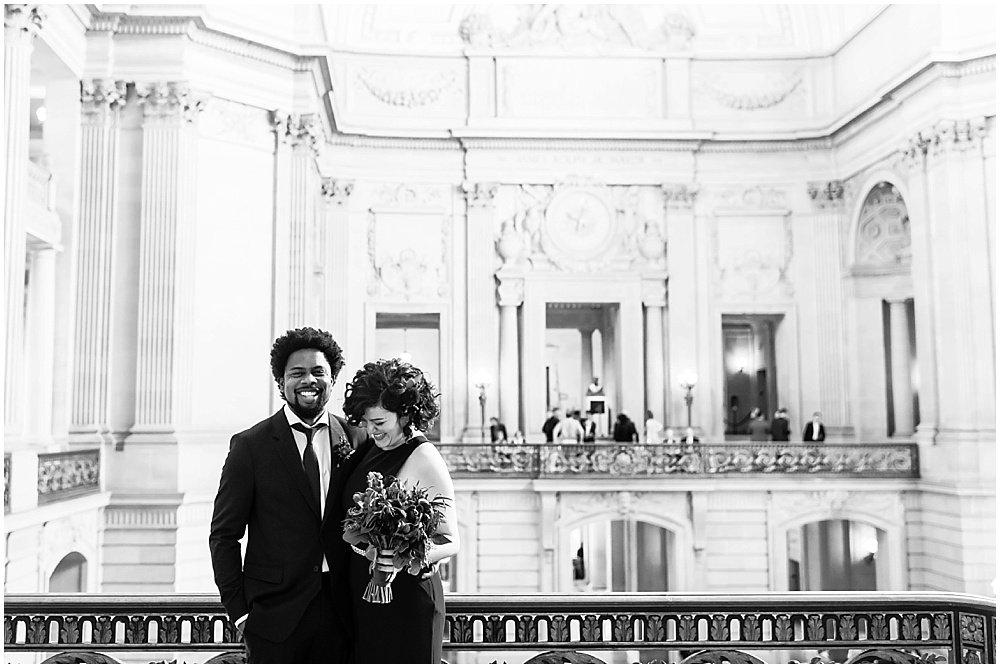 Amanda and Aaron laugh at San Francisco City Hall Wedding by chloe jackman photography