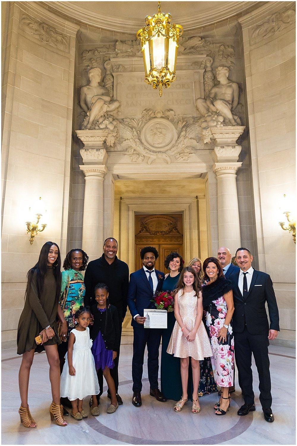 Group photo at San Francisco City Hall Wedding by chloe jackman photography