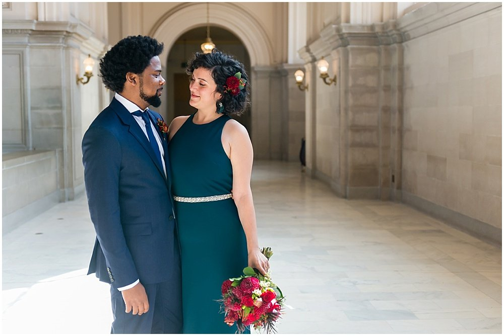Couple gaze at eachother at San Francisco City Hall Wedding by chloe jackman photography