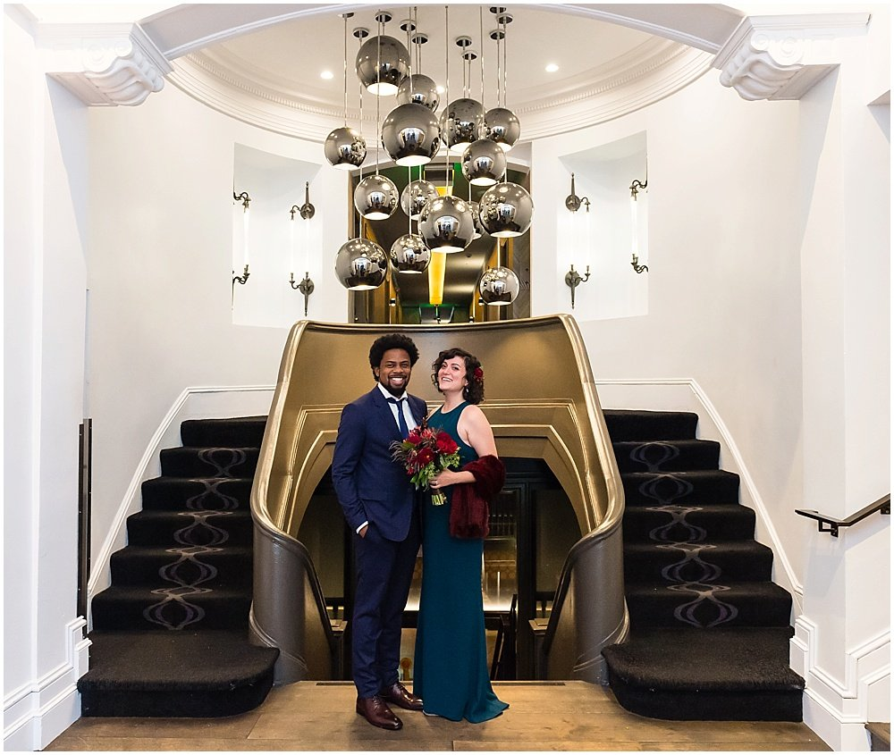 Couple pose at stairwell of hotel zeppelin by chloe jackman photography