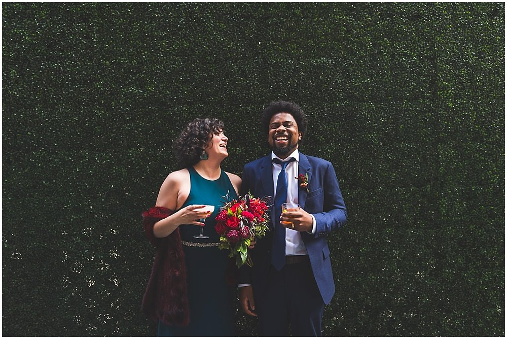 Bride and groom laugh outside San Francisco City Hall Wedding by chloe jackman photography