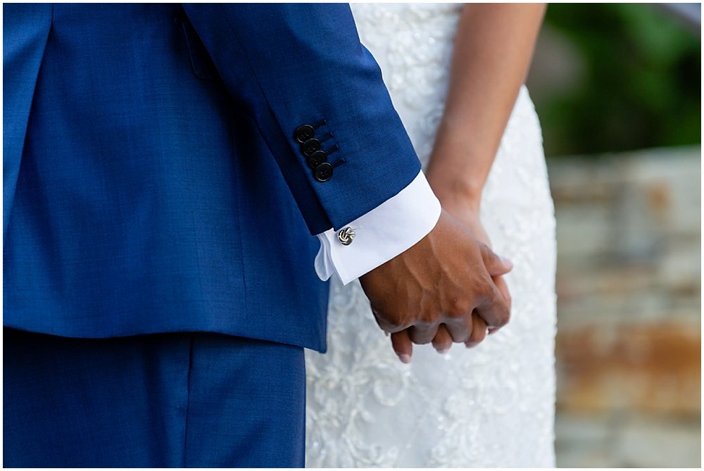 holding hands at tehama golf club wedding by chloe jackman photography