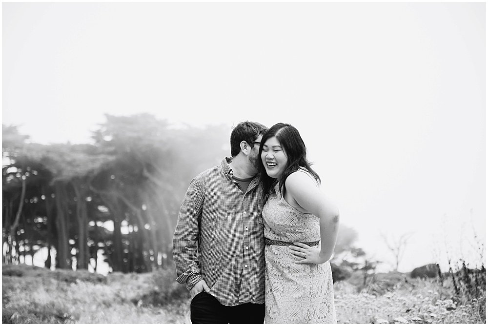 kissing candid during SF engagement photography by Chloe Jackman Photography