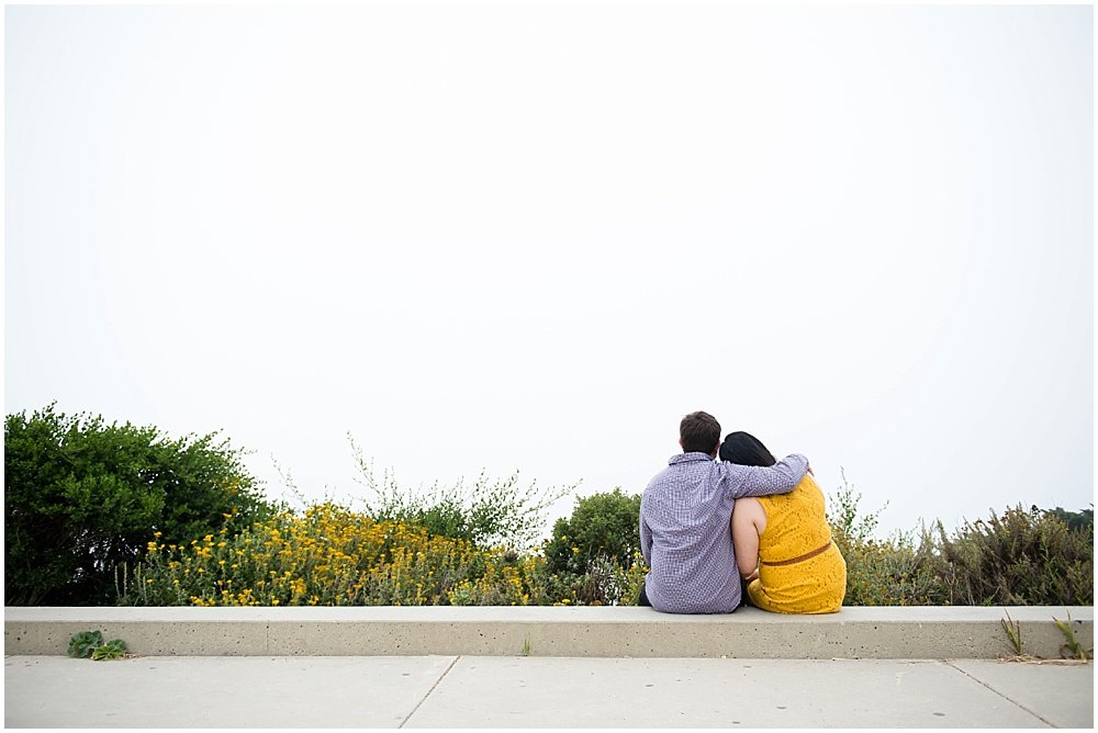 couple looking into fog bank during san francisco engagement shoots by Chloe Jackman Photography
