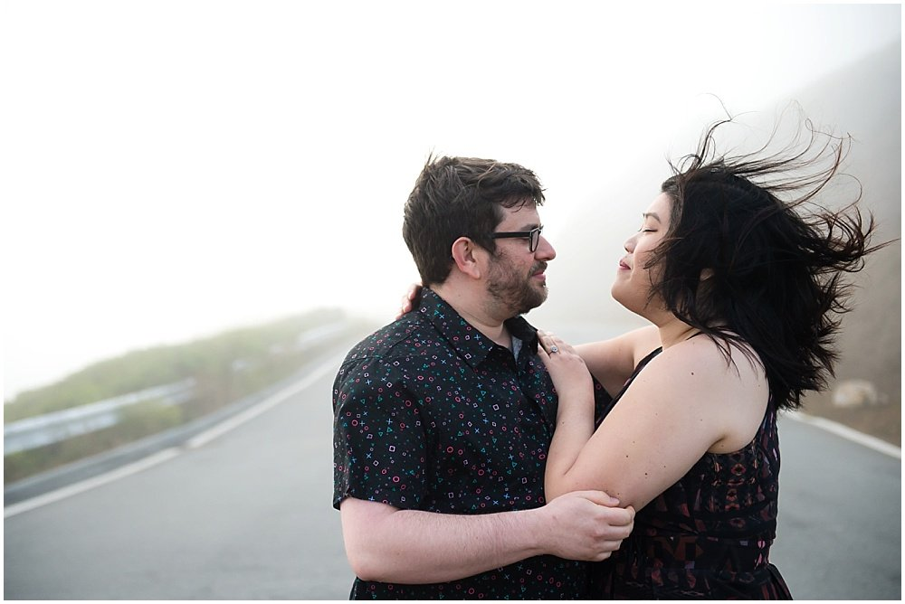 Fiance hair blowing in the wind for SF engagement photography by Chloe Jackman Photography