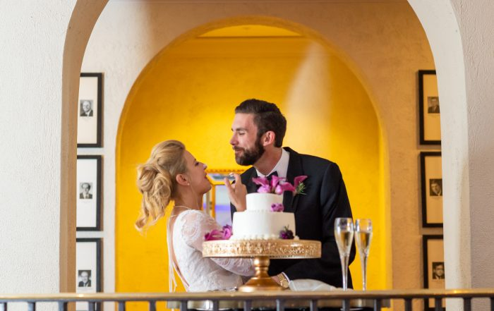 bride and groom eat cake at Olympic Club wedding