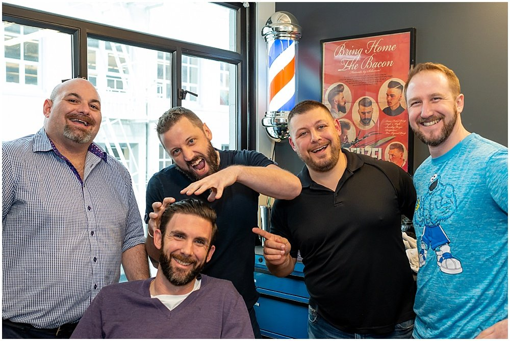 Group shot at barber shop before wedding