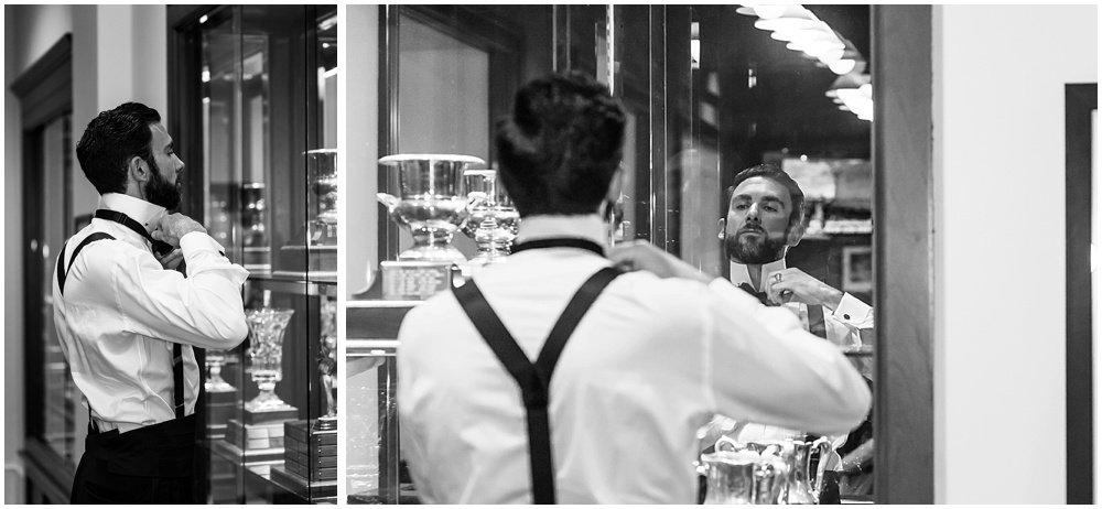 Groom fixes tie in Olympic Club Wedding mirror by chloe jackman photography