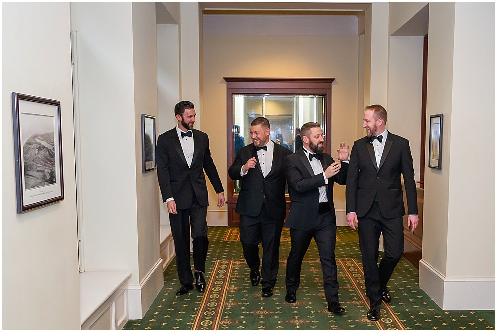 Groomsmen joke around with groom before Olympic Club Wedding