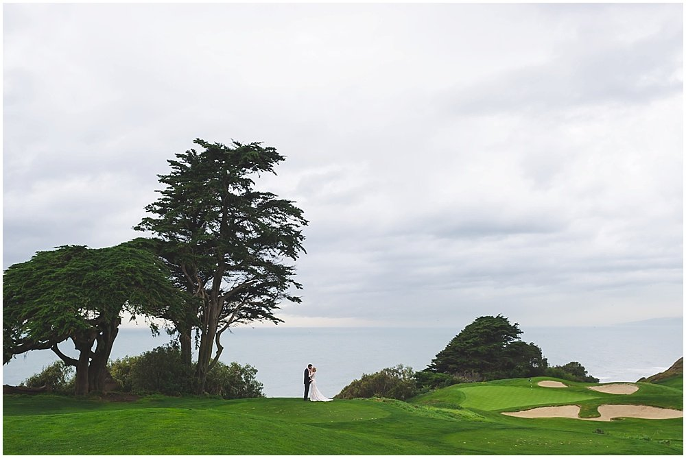 Bride and groom look out at ocean before Olympic Club Wedding by chloe jackman photography