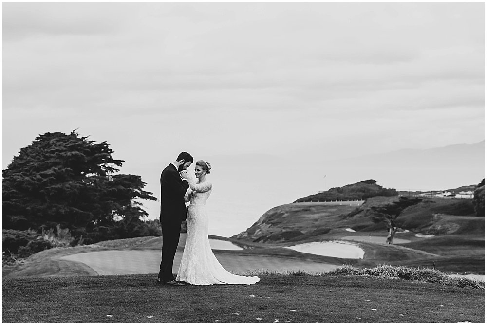 black and white photo of groom kissing bride's hand at golf course before Olympic Club Wedding by chloe jackman photography