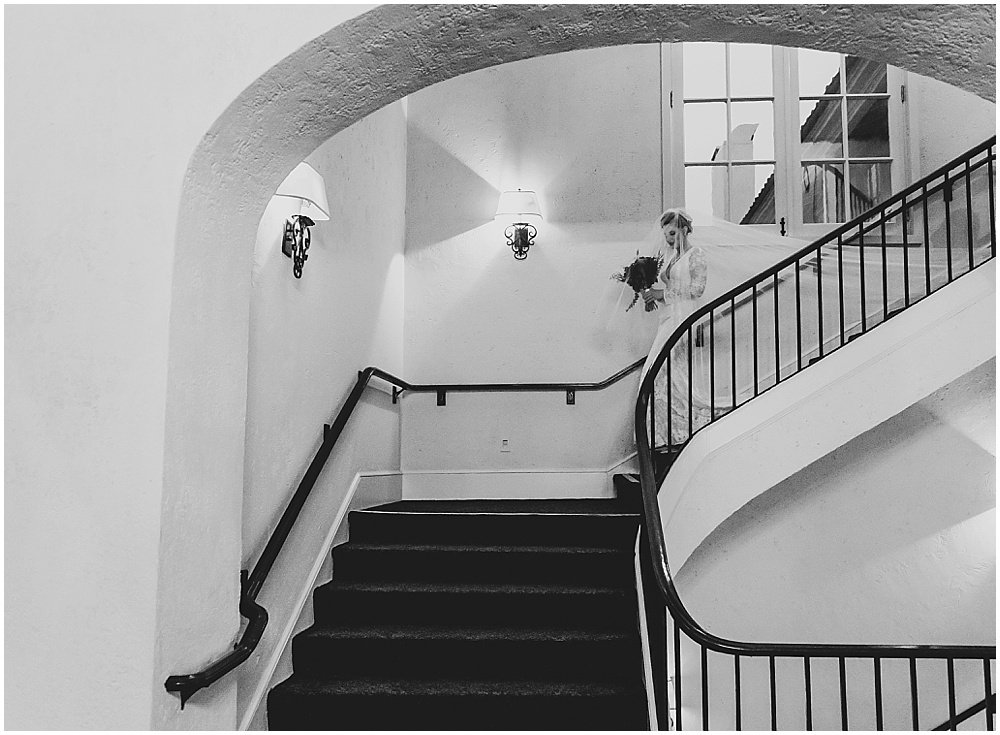 Bride walks down the stairs to Olympic Club Wedding by chloe jackman photography