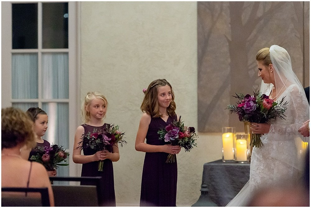 Bride looks back at daughters during by chloe jackman photography