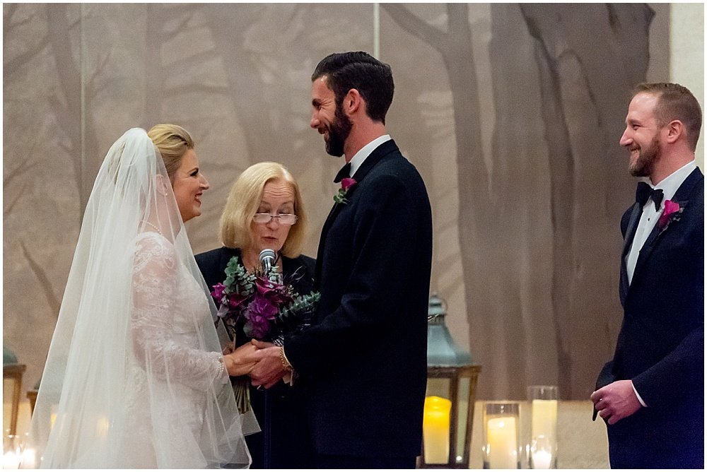 Bride and groom smile at each other during ceremony at Olympic Club Wedding by chloe jackman photography