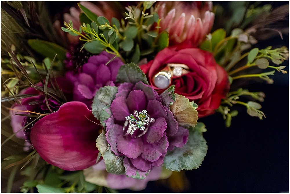 Close up of daughters rings in red and purple bouquet