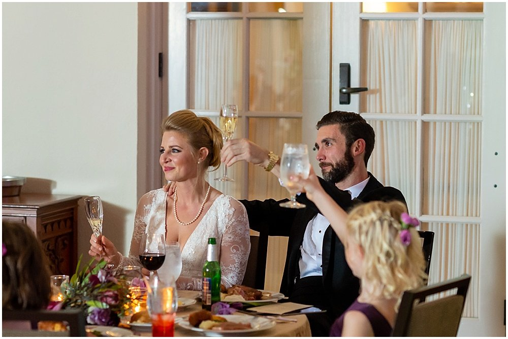 Family memebers make a speech while the bride and groom toast, by chloe jackman photography