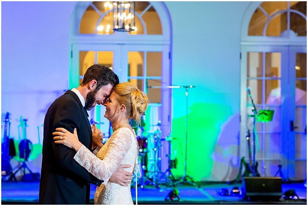 Bride and groom laugh during dance at Olympic Club Wedding reception by chloe jackman photography