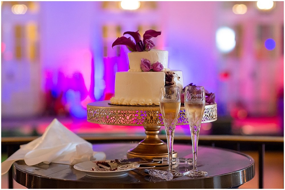 Wedding cake with slice eaten out of it at Olympic Club Wedding by chloe jackman photography