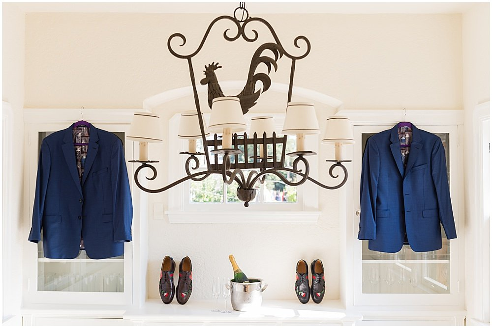 Grooms suits hung up before Tre Posti Wedding by chloe jackman photography