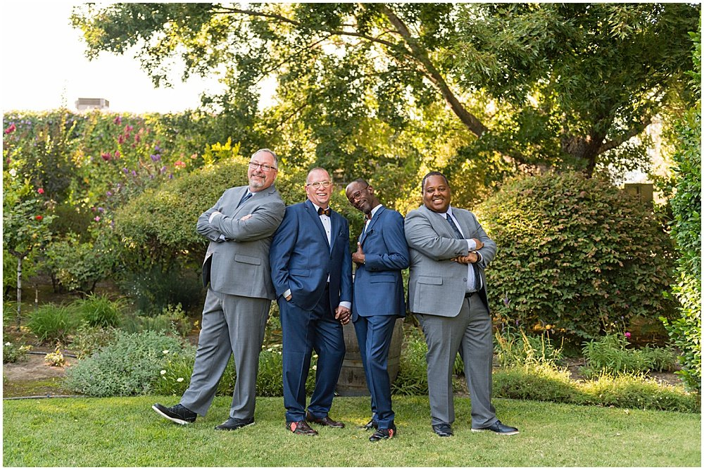 groomsmen and grooms strike a pose before Tre Posti Wedding by chloe jackman photography