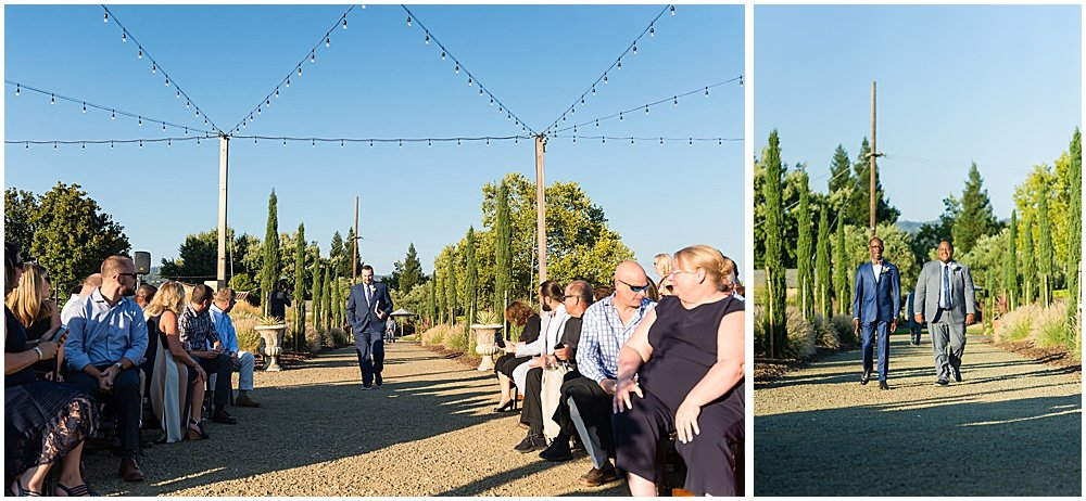 Grooms walk down aisle of Tre Posti Wedding by chloe jackman photography
