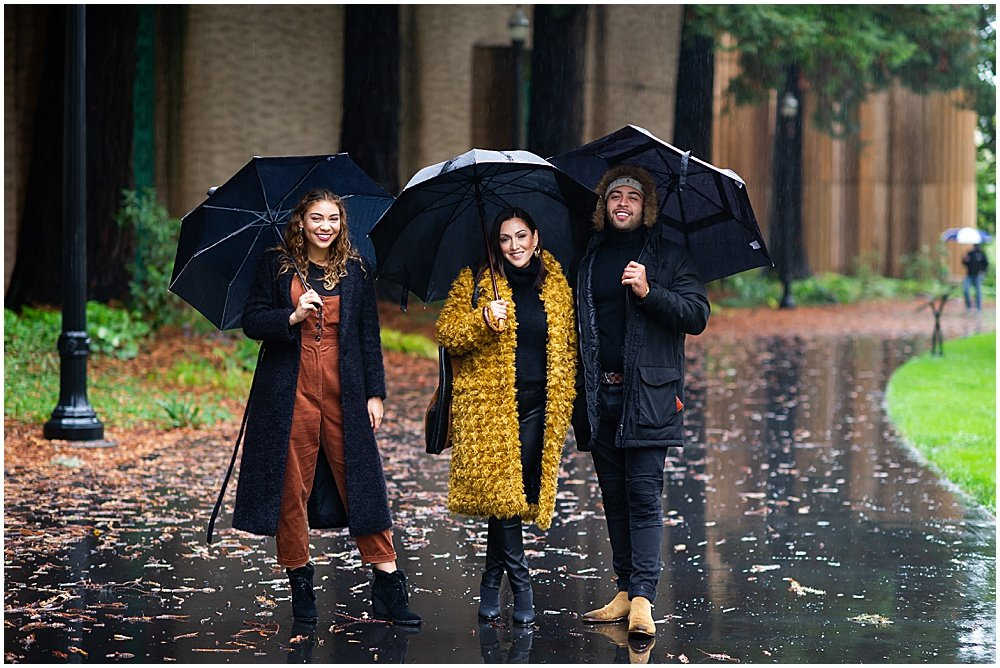 Family smiles in the rain for Bay Area Family Photography by chloe jackman photography