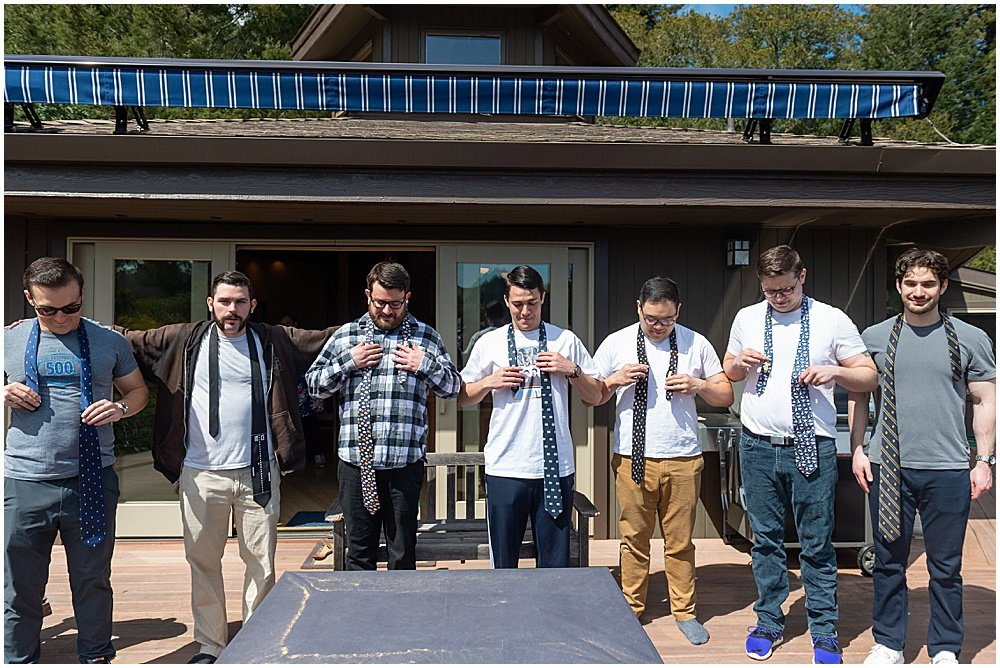 Groomsmen tying ties before Deer Park Villa Wedding Fairfax