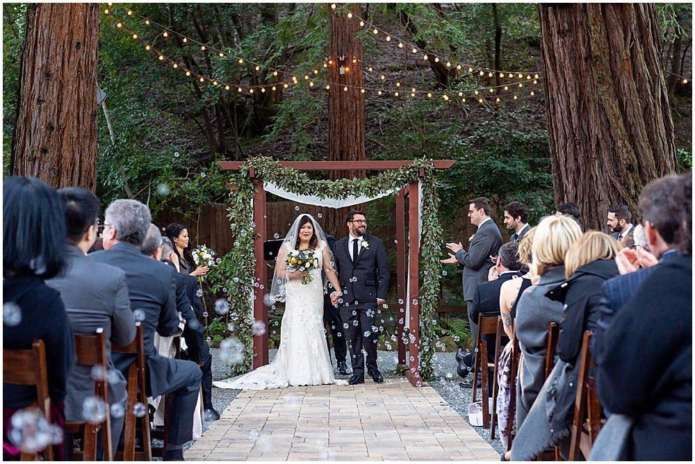 bubbles walking down the aisle at Deer Park Villa Wedding Fairfax by chloe jackman photography