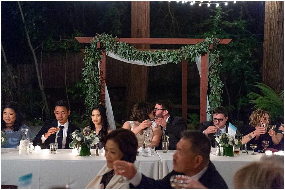 kiss during speeches at Deer Park Villa Wedding Fairfax