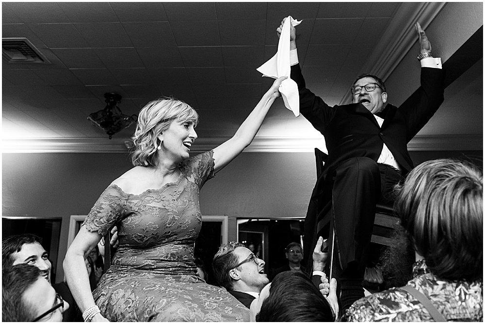 grooms parents at Deer Park Villa Wedding Fairfax chair dance