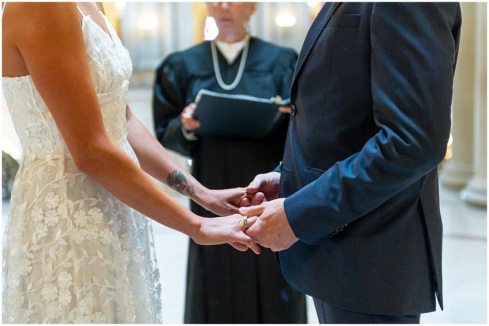 holding hands sf city hall weddings