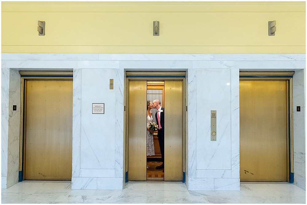 bride and groom in the elevator sf city hall weddings