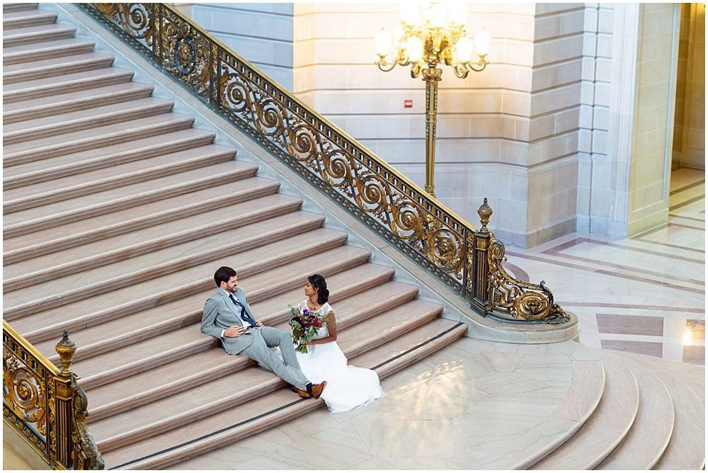 San Francisco city hall wedding on the staircase