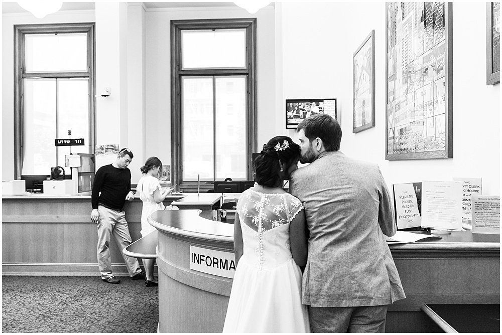 filling out the paperwork san francisco city hall wedding