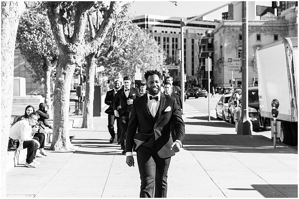 Groom and groomsmen in San Francisco Civic Center Plaza