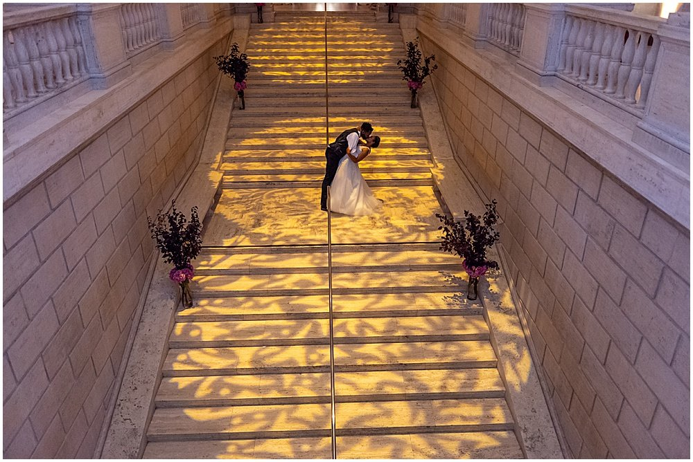 Kissing the Bride on the Grand Staircase San Francisco Asian Art Museum Wedding