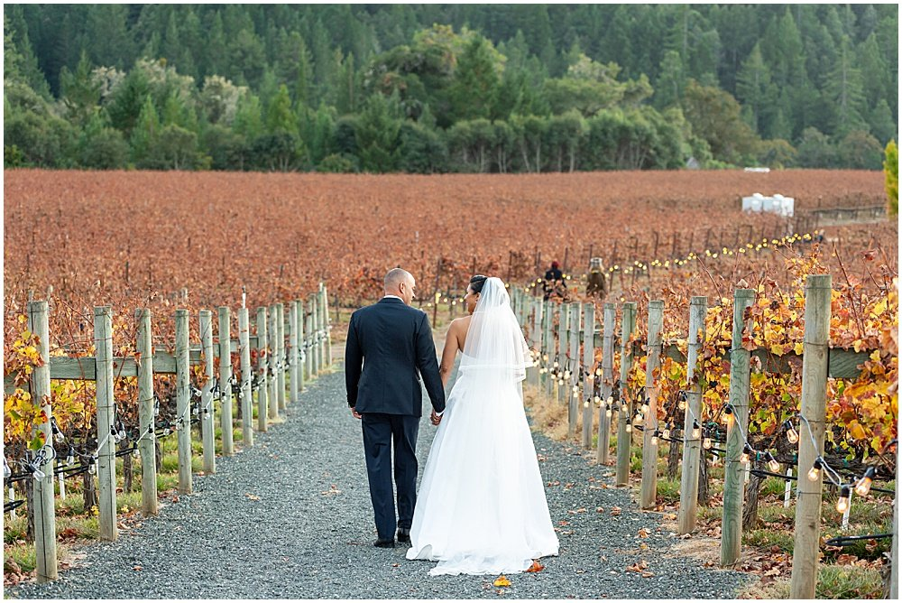 Walking through the vines at Goldeneye Winery wedding