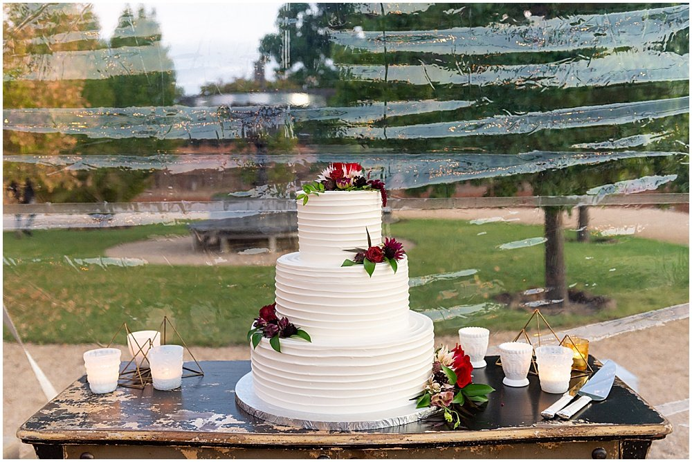 three tiered cake with candles