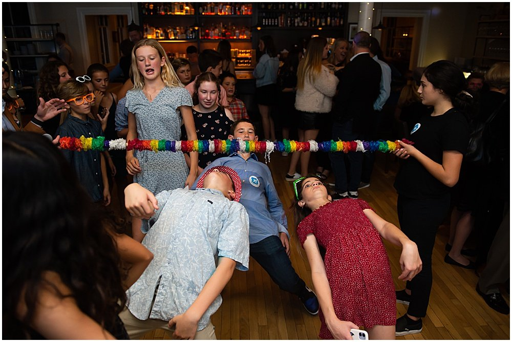 Kids playing limbo at a bat mitzvah