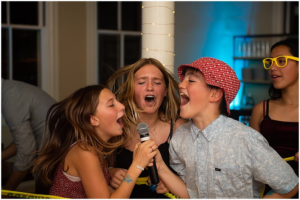 Singing karaoke at a bat mitzvah